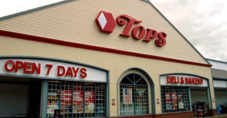Tops cuts losses in 2Q; deflation dings comps