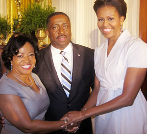 Gregory Calhoun (pictured with his wife) meets First Lady Michelle Obama as part of his efforts to build stores in underserved areas.