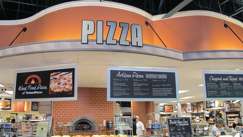 The centerpiece of the store is a massive kitchen featuring a wood-fired pizza oven.