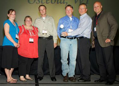 From left: Susan Hubred, Rhonda Kobernick, Aaron Thoms, Tim Adams and Doug Rinehart, Dick's Fresh Market, Osceola, Wis.; Scott Morris, Supervalu.
