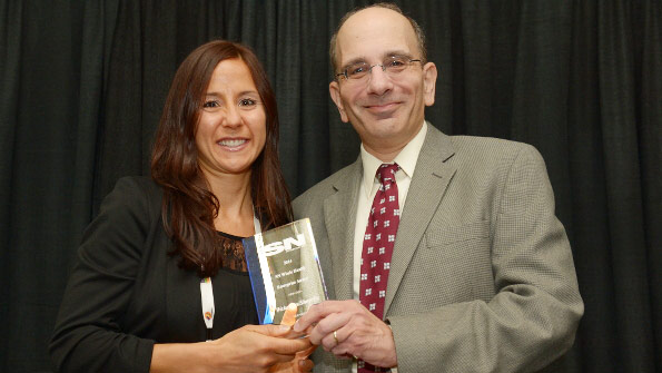 Natalie Menza, manger of health and wellness for Wakefern, accepts SN's 2014 Whole Health Enterprise Award from David Orgel, executive director, content & user engagement.