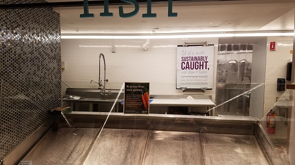A nearly empty seafood section and a notice to customers pointed to supply issues at the New York store Friday.